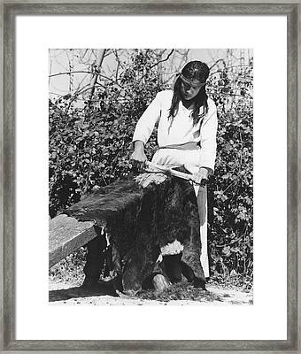 Scraping A Bear Hide Framed Print