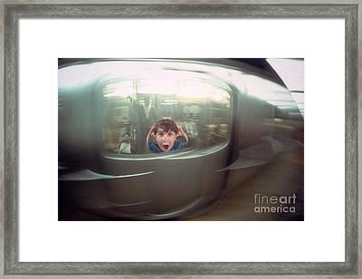 Screaming Boy On Speeding Subway Framed Print
