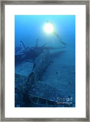 Scuba Divers Exploring Airplane Wreck Framed Print by Sami Sarkis
