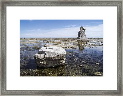 Framed Print featuring the photograph Sculpted Rock On Naked Isld by Arkady Kunysz