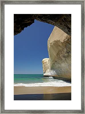 Sea Cave, Beach And Cliffs, Tunnel Framed Print by David Wall