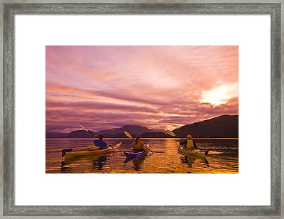 Sea Kayakers Paddle Around Near Island Framed Print by Michael DeYoung