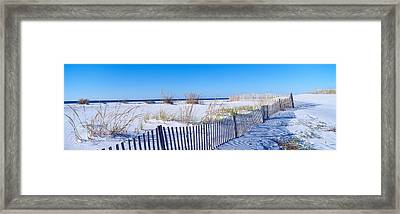 Sea Oats And Fence Along White Sand Framed Print by Panoramic Images