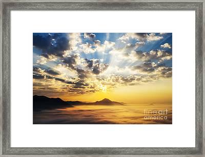 Sea Of Clouds On Sunrise With Ray Lighting Framed Print by Setsiri Silapasuwanchai