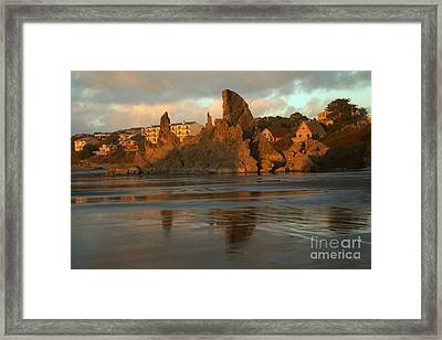 Sea Stacks And The City Framed Print by Adam Jewell