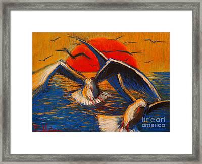 Seagulls At Sunset Framed Print by Mona Edulesco