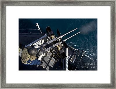 Seaman Fires Twin .50 Caliber Machine Framed Print by Stocktrek Images