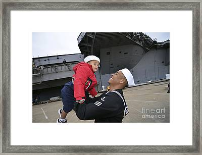 Seaman Greets His Son Framed Print by Stocktrek Images