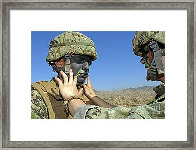 Seaman Has His Face Painted To Help Framed Print by Stocktrek Images