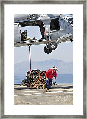 Seaman Hooks A Pallet To An Mh-60s Sea Framed Print by Stocktrek Images