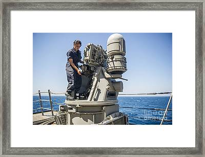 Seaman Performs Maintenance On A Mark Framed Print by Stocktrek Images