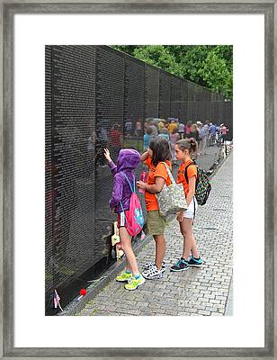 Searching A Loved Ones Name On The Vietnam Veterans Memorial Framed Print by Jim Fitzpatrick