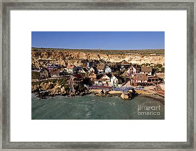 Seaside Village Under The Cliffs Framed Print