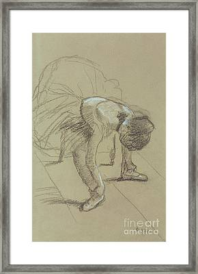 Seated Dancer Adjusting Her Shoes Framed Print by Edgar Degas