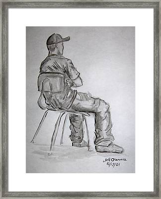 Seated Man In Ball Cap Framed Print by Jeffrey Oleniacz