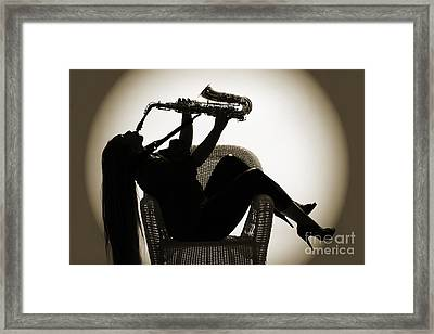 Seated Saxophone Playere Framed Print