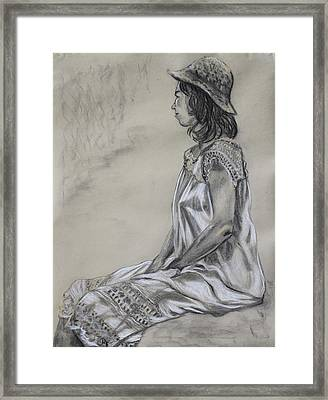 Seated Woman In A White Dress And Straw Hat Framed Print