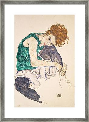 Seated Woman With Legs Drawn Up. Adele Herms Framed Print by Egon Schiele
