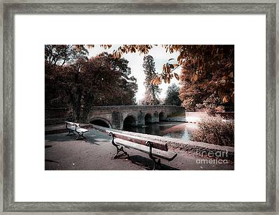 Seats By The River Framed Print