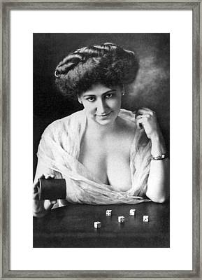 Seductive Woman Rolls The Dice Framed Print by Underwood Archives