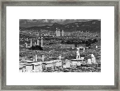 Seeing Ruins On Delos Island Framed Print by John Rizzuto