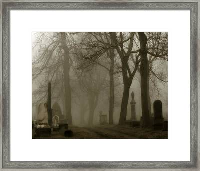 A Graveyard Seeped In Fog Framed Print