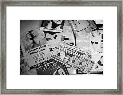 Selection Of Leaflets Advertising Girls Laid Out On A Hotel Bed With Us Dollars Cash In An Envelope  Framed Print by Joe Fox