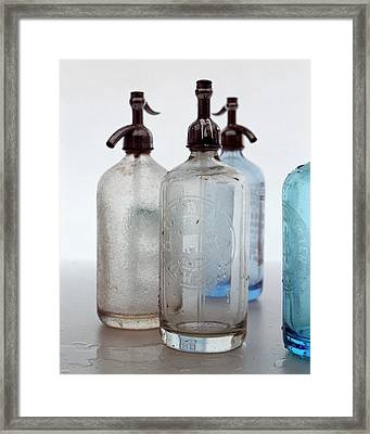 Seltzer Bottles Framed Print by Romulo Yanes