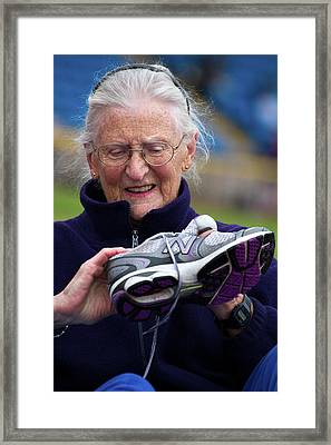 Senior Athlete With Sports Shoe Framed Print by Alex Rotas