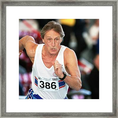 Senior British Masters Athlete Running Framed Print by Alex Rotas