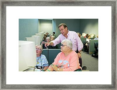 Senior Citizens Learning To Use Computers Framed Print by Jim West
