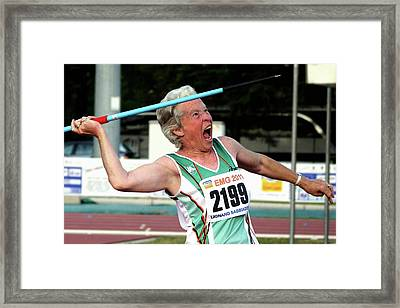 Senior Female Athlete Throws Javelin Framed Print