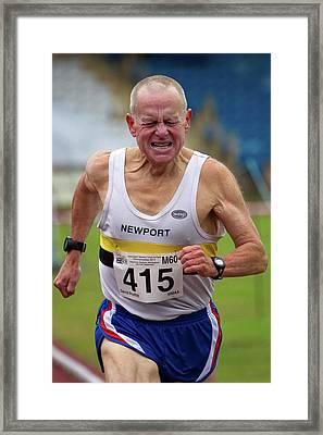 Senior Male Athlete Runs Through The Pain Framed Print by Alex Rotas