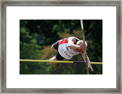 Senior Pole Vaulter Clearing The Bar Framed Print