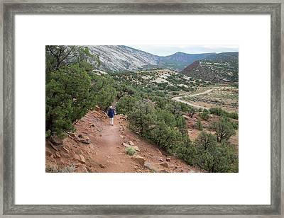 Senior Woman Hiking Framed Print by Jim West
