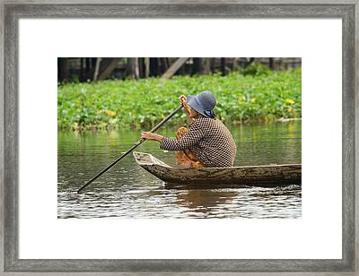 Senior Woman Paddling A Boat Framed Print