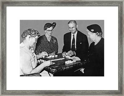 Seniors Playing Dominos Framed Print by Underwood Archives