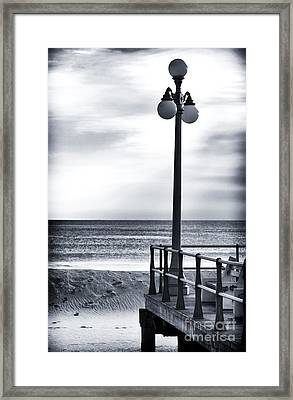Serenity At The Shore Framed Print by John Rizzuto