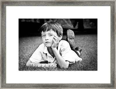 Serious Child Framed Print by Tom Gowanlock