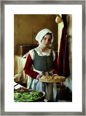 Serving The Bread Framed Print