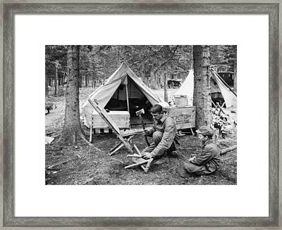 Setting Up Camp Framed Print by Underwood Archives