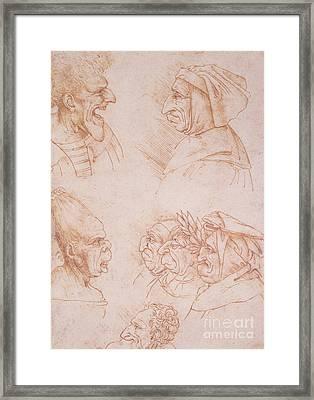 Seven Studies Of Grotesque Faces Framed Print by Leonardo da Vinci