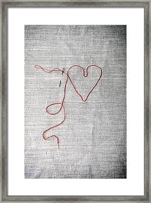 Sewing A Heart Framed Print