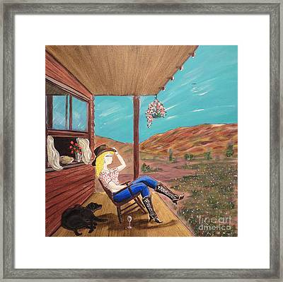 Sexy Cowgirl Sitting On A Chair At High Noon Framed Print by John Lyes