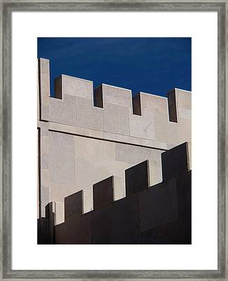 Shadow Cast On The Wall Of A Winery Framed Print by David H. Wells