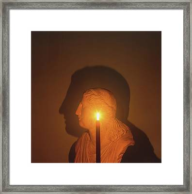 Shadow Of A Bust In Candle Light Framed Print