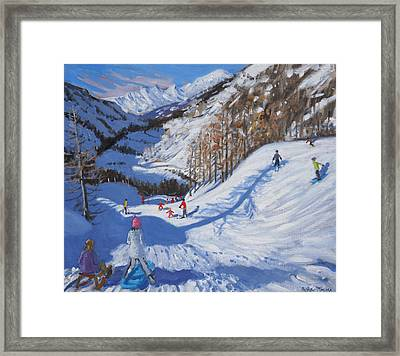 Shadow Of A Fir Tree And Skiers At Tignes Framed Print by Andrew Macara