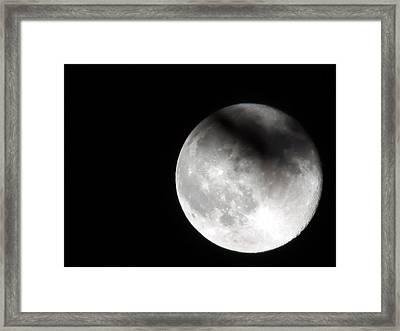 Shadow On The Moon Framed Print