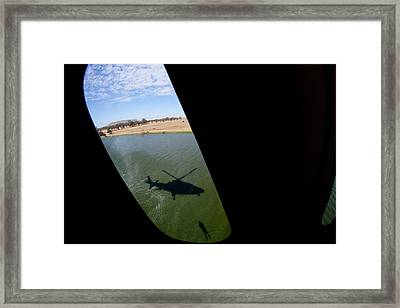 Shadow Rescue  Framed Print by Paul Job