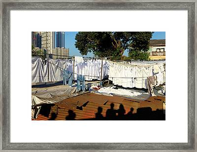 Shadows Of People Walking By Laundry Framed Print by Jill Schneider